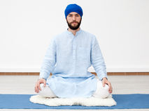 Yogi man sitting on the mat
