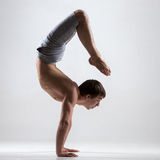 Yogi man in yoga Scorpion Pose, side view Royalty Free Stock Image