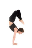 Yogi man in yoga Scorpion Pose Vrischikasana 2 Stock Images