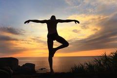 Yogi meditating at sunset Stock Images