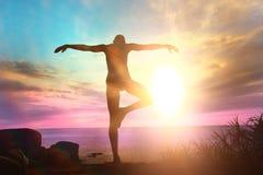 Yogi meditating at sunset Royalty Free Stock Image