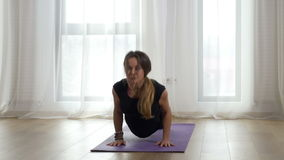 Yogi practicing yoga sequence at a gym stock footage