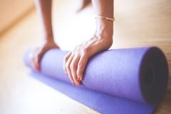 Woman doing yoga at wooden floor Royalty Free Stock Photography