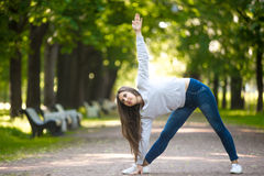 Yogic workout on park alley Stock Images