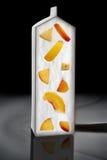 Yogur de la plantilla con los melocotones Imágenes de archivo libres de regalías