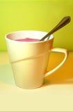 Yogurt. White cup full of fruit yogurt stock photography