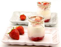 Yogurt. Cream with strawberry jam on a tray Stock Photography