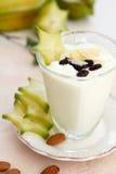 Yogurt with almond and starfruit Stock Photos