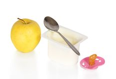 Yogurt, apple and the pacifier Royalty Free Stock Image