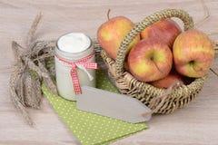 Yogurt and apples Stock Image
