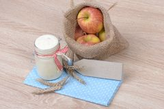 Yogurt and apples Stock Photos