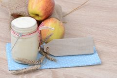 Yogurt and apples Stock Images