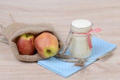 Yogurt and apples Stock Photography