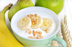 Yogurt with banana and cereals Stock Photography