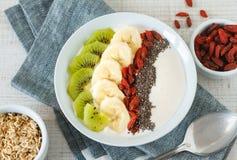 Yogurt with banana, kiwi, chia seeds,goji berries and oats Royalty Free Stock Photography