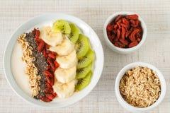 Yogurt with banana, kiwi, chia seeds,goji berries and oats Stock Photos