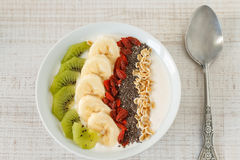 Yogurt with banana, kiwi, chia seeds,goji berries and oats Stock Image