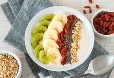 Yogurt with banana, kiwi, chia seeds,goji berries and oats Royalty Free Stock Images