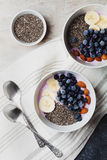Yogurt with berries, banana, almonds and Chia seeds, bowl of healthy Breakfast every morning, vintage style, superfood and detox Stock Image