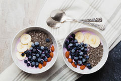Yogurt with berries, banana, almonds and Chia seeds, bowl of healthy Breakfast every morning, vintage style, superfood and detox Royalty Free Stock Images