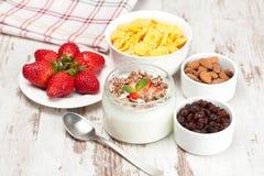 Yogurt with berries and breakfast foods, closeup Stock Photos