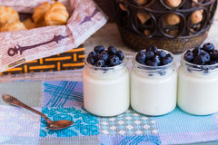 Yogurt with berries in a glass jar. Homemade yogurt with blueberries in a glass jar Stock Photography