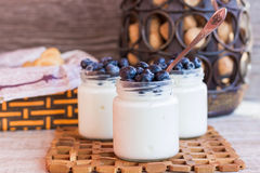 Yogurt with berries in a glass jar. Homemade yogurt with blueberries in a glass jar Royalty Free Stock Photography