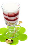 Yogurt with berries and granola in a tall glass. Stock Images