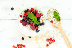 Yogurt with berries and oat flakes Stock Photos