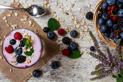 Yogurt with berries, oat flakes and mint. top view Stock Images