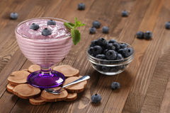 Yogurt with blueberries in a glass bowl and blueberries in a gla Royalty Free Stock Photography