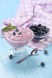 Yogurt with blueberries in a glass bowl and blueberries in a gla Stock Images