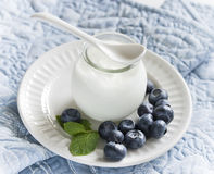 Yogurt with blueberries in a glass jar Stock Photos