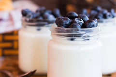 Yogurt with blueberries in a glass jar. Homemade yogurt with blueberries in a glass jar Stock Photo