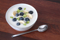 Yogurt with blueberries, kiwi and banana slices Royalty Free Stock Photo