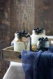 Yogurt with blueberries on tray Stock Photo