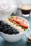 Yogurt bowl with banana and berries Stock Photography