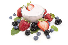 Yogurt in a bowl with berries Stock Photo