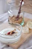 Yogurt bowl with granola on background Royalty Free Stock Images