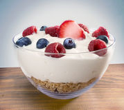 Yogurt in bowl on wood Stock Photo