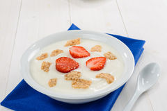 Yogurt, cereal and strawberries Royalty Free Stock Images