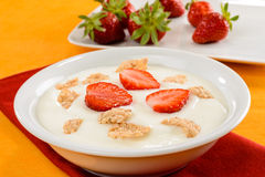 Yogurt, cereal and strawberries Stock Photo
