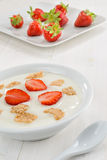 Yogurt, cereal and strawberries Stock Photography