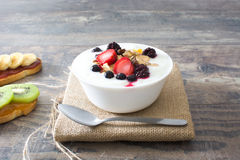 Yogurt with cereals and berries. Stock Photo