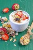 Yogurt with cereals muesli and fresh strawberries Royalty Free Stock Photography