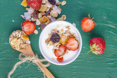 Yogurt with cereals muesli and fresh strawberries Royalty Free Stock Image