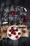 Yogurt with cherry Stock Images