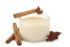 Yogurt and cinnamon. Fresh yogurt and cinnamon on white background royalty free stock images