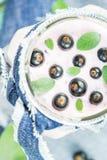 Yogurt cocktail black currant melissa. Yogurt cocktail with black currant and melissa royalty free stock images