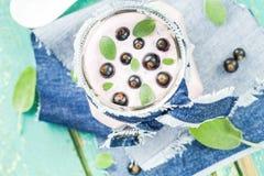 Yogurt cocktail black currant melissa. Yogurt cocktail with black currant and melissa royalty free stock photo